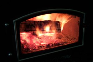 Logs burning in a wood stove
